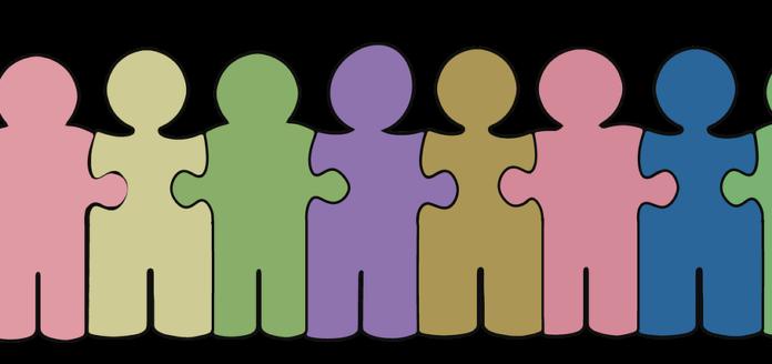 Eine Menschenkette aus Puzzleteilen als Symbolbild für Genossenschaft